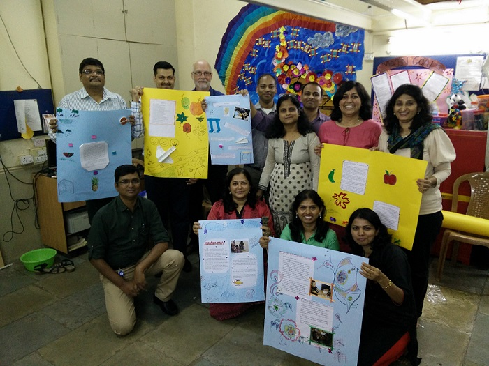Employees from Johnson & Johnson with educational material done by them at Byculla.